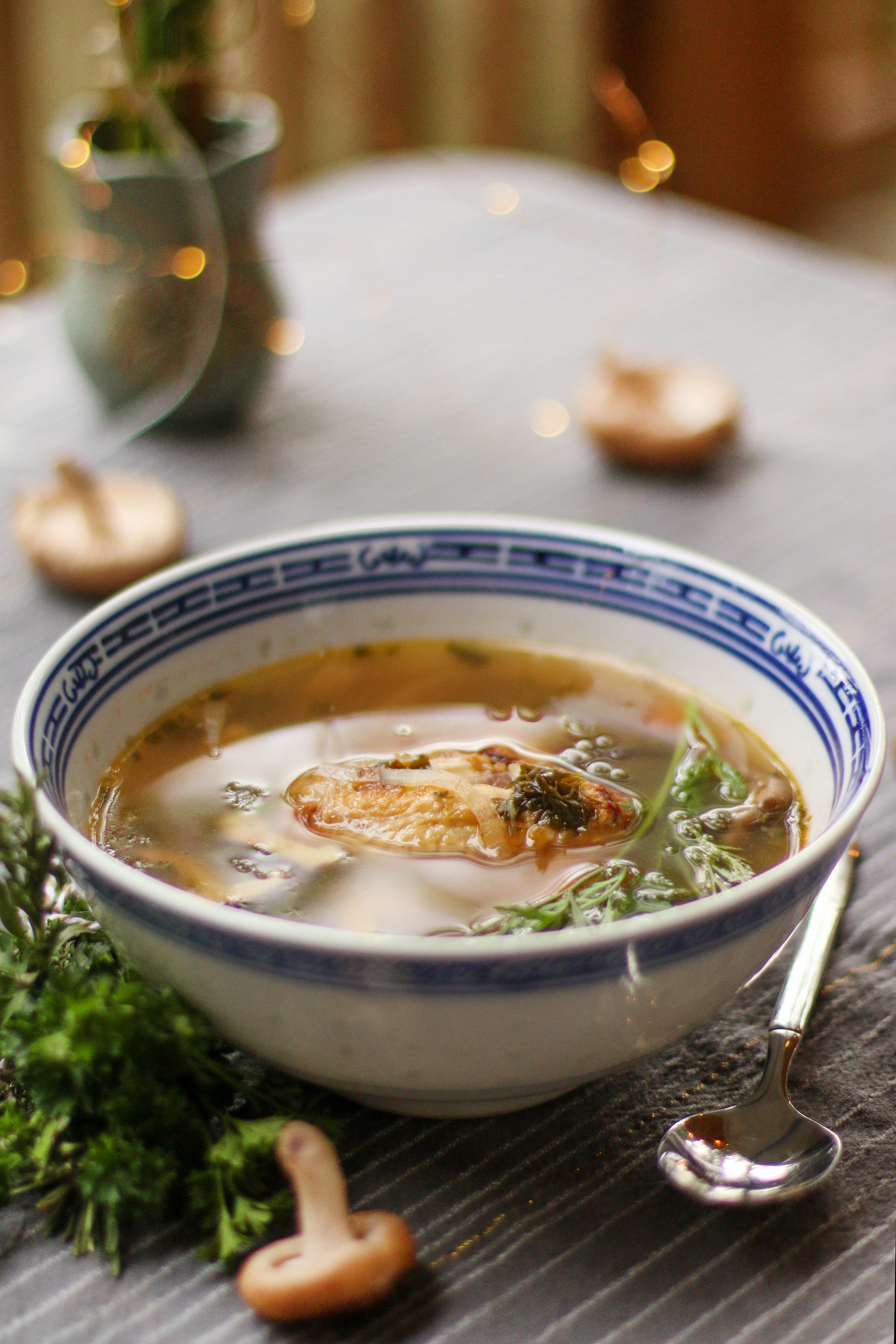 chicken-and-vegetale-soup-in-asian-bowl-surrounded-by-fresh-ingredients